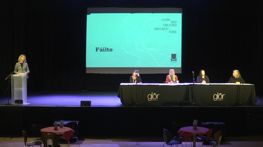 Helen Caroll looks towards the four pannelists on stage