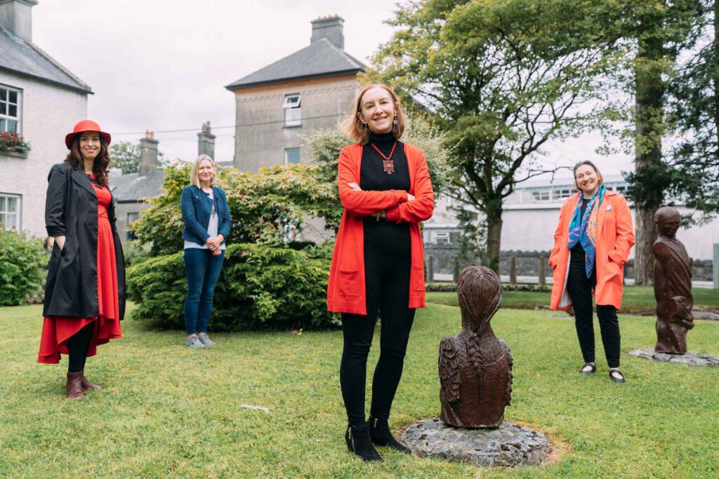 4 ladies standing in a sculpture garden
