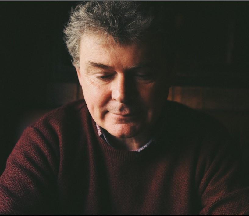 Head shot of John Spillane gazing downwards